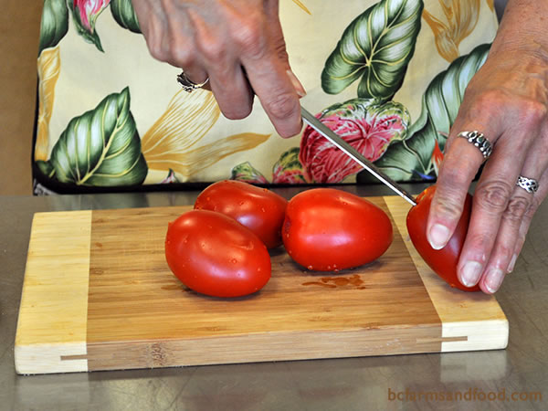 Core and slice the tomatoes into wedges.