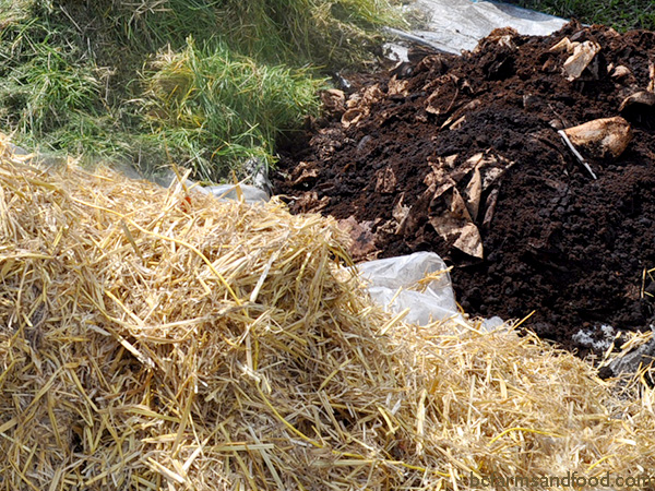 Stacks of hay, grass clippings and coffee grounds for use as natural soil amendments.