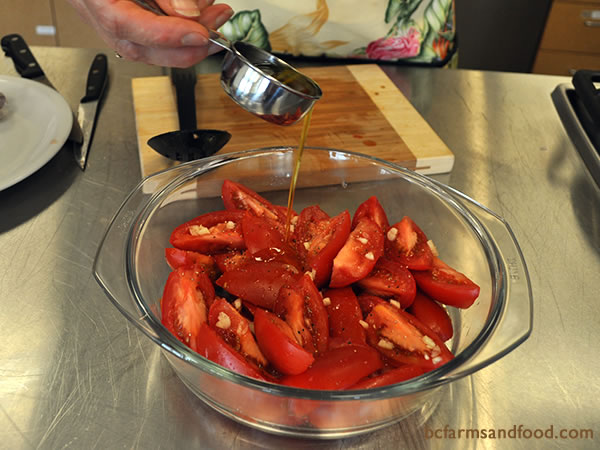 Drizzle extra-virgin olive oil over the tomatoes and garlic. Add black pepper.