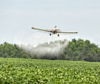 A plane sprays pesticides on crops. Tests Reveal Benefits of Eating Organic Food.