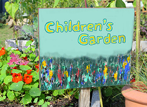 """Children's Garden"" sign. School Gardens: Preparing Kids for Climate Change."