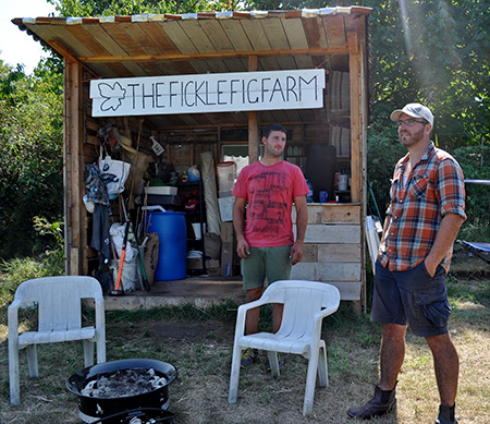 Mitchell Morse and Chris Margetts stand in front of the tool shed at The Fickle Fig Farm.