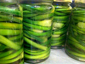 Jars of canned garlic scapes