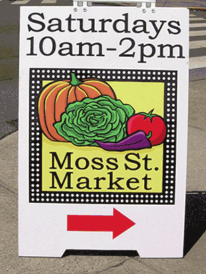 A signboard to guide shoppers to the Moss Street Market, one of the Vancouver Island farmers markets