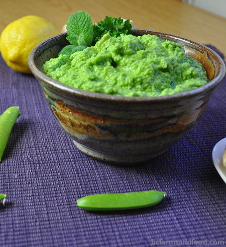 A bowl of bright green pea dip, a fresh light appetizer or spread. Green Pea and Parmesan Dip.