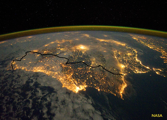 An aerial view of Portugal lit up at night. Portugal ran the entire electrical grid on renewable energy for four days.