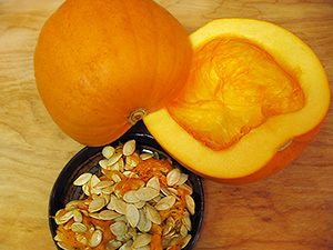 A pumpkin split in half with the seeds and pulp scooped out.