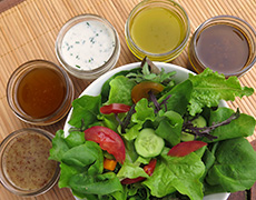 Homemade Classic Salad Dressings with a green salad. Staple Food Recipes You Can Make at Home.
