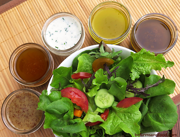 A fresh green salad with five classic salad dressings: honey mustard, balsamic vinaigrette, ranch, Italian and sesame ginger.