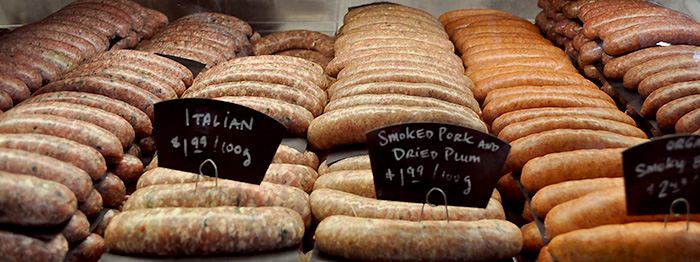Artisan sausages on display at the Village Butcher in Victoria, BC.
