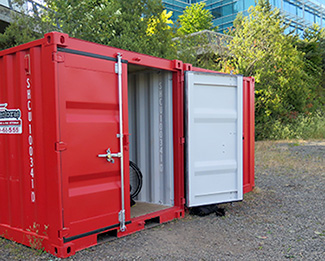 A 56 foot metal shipping container at Topsoil urban farm. At the end of the season the grow bags can be folded and stored in this small space. A movable urban farm.